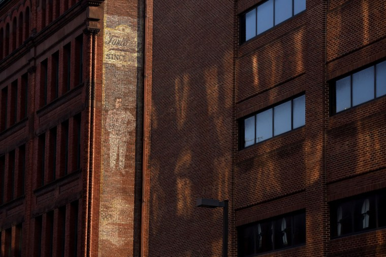 A vertical advertisement adorns a wall of the former Faultless Pajama Company factory on S. Paca Street. (Kim Hairston/Baltimore Sun)