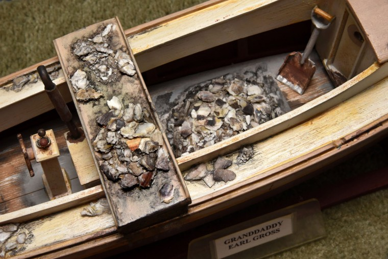 "A haul of oysters is displayed in miniature on the ""Ruth Ann,"" the skiff belonging to Norman Gross' grandfather, Earl Gross. Norman recalled that when he went out with his grandfather, they could catch 50 to 100 bushels of oysters a day, and there was no limit placed on your catch. (Amy Davis / The Baltimore Sun)"