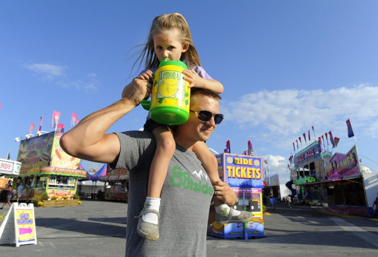 Steve Jarosinski and his daughter, Katalina, 3, of Ellicott City, enjoy a lemonade at the fair.(Lloyd Fox/Baltimore Sun)