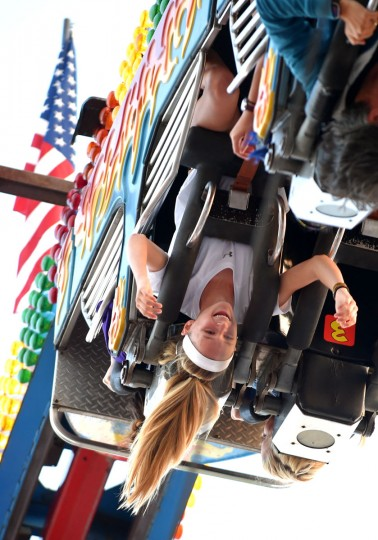 Madilyn Geidel, 13, of Eldersburg, upside down on the Fire Ball ride.   (Lloyd Fox/Baltimore Sun)