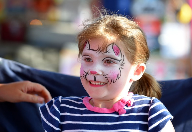 Kara Krickler ,5, of Freeland has her face painted at the fair. (Lloyd Fox/Baltimore Sun)