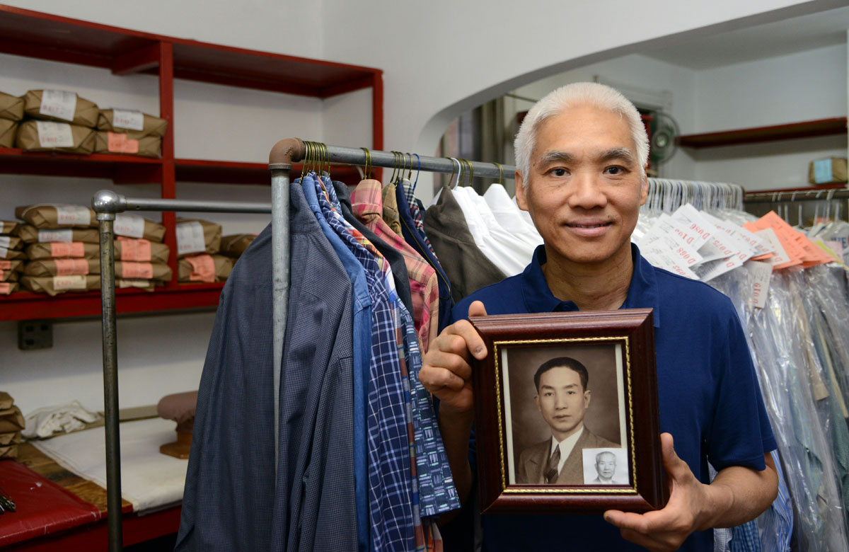 Ricky Tsao holds a photograph of his grandfather, Chak Wing Tsao, in the family's T.C. Wing Chinese Hand Laundry.  His grandfather, who died in 1995, started the business in 1932.