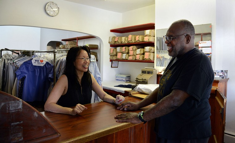Shirley Tsao, whose family owns TC Wing Laundry in Roland Park, chats with long-time customer Charles Johnson of Baltimore, who is a retired equities trader and investment banker.