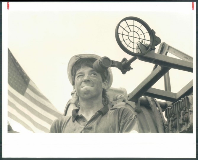 July 26, 1991-PIER #1 CLINTON STREET--Paul Day takes time to look through the gun sites (his grandad helped build the ship). Photo by Sun photographer William G. Hotz.