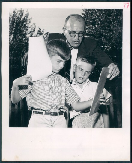 DON'T LOOK NOW: Dr. Bernard A. Sallyslak shows son, Billy, 6, left, and neighbor Philip DeLoache, 8, how to watch the eclipse without any danger of injuring their eyes. Photo from July 1963. (Tadder/Baltimore Sun)
