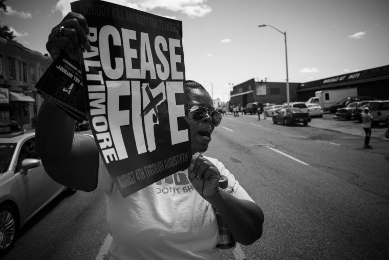 Baltimore, MD -- 8/5/2017 -- Joanne Montaque, from Baltimore. Day 2 of the 72 hours Baltimore Ceasefire. HUG DON'T SHOOT groups march from Druid Hill Park to Pennsylvania Avenue and North Avenue. Supporters gives out countless hugs and water to local Baltimore city residents. (Photo and caption by Paul Lai)