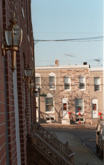 "A row of brass lamps adorn homes on the 600 block of Harvey Street in South Baltimore Friday Dec. 27, 1996, as homes covered in formstone line up in the background on Belt Street. A former Baltimore city planner calls ""The March of the Brass Lamps"" the movement of gentrification into South Baltimore. As blocks become gentrified and improved, housing prices have risen, changing the South Baltimore neighborhood from an old traditional area to a yuppie neighborhood. Many newcomers have had the formstone removed from their buildings, exposing the brick underneath, while the older, established neighbors are resisting the change. (Nanine Hartzenbusch/Baltimore Sun archives)"