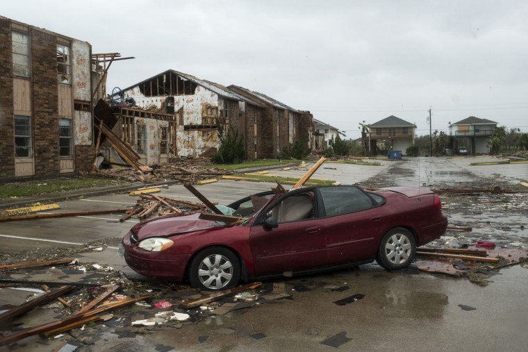 A vehicle sits damaged by debris after Hurricane Harvey hit Rockport, Texas, on Aug. 26, 2017. (Alex Scott/Bloomberg)