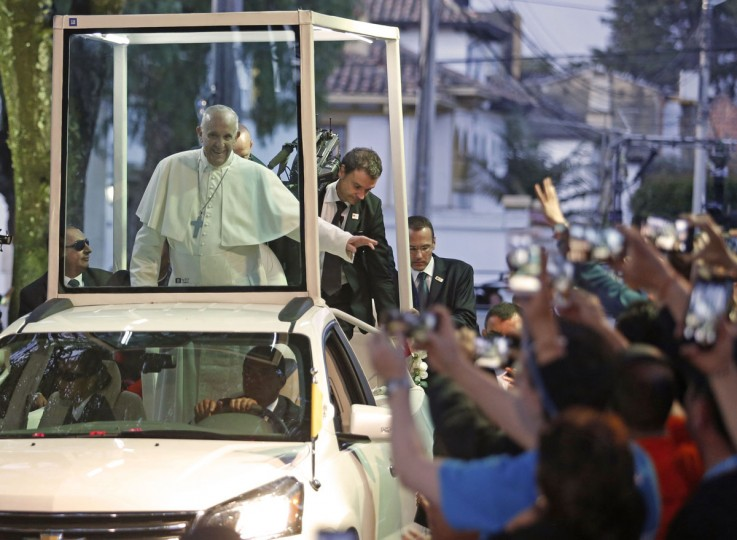 Pope Francis waves to faithful in Colombia. AFP PHOTO / John Vizcaino