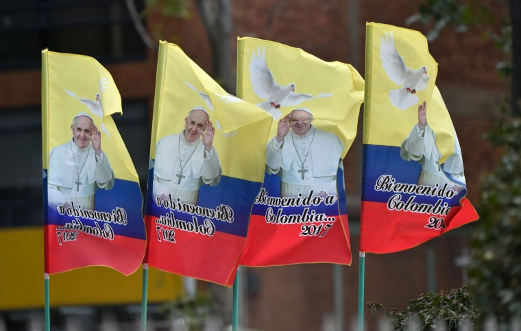 Flags commemorating the visit of Pope Francis to Colombia, are sold at a stand set up along the route to be taken by the pontiff. AFP PHOTO / Rodrigo BUENDIA