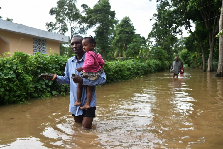 A man walks in street that was flooded in Malfeti, in the city of Fort Liberte, in the north east of Haiti, on September 8, 2017, during the passage of Hurricane Irma. (HECTOR RETAMAL/AFP/Getty Images)