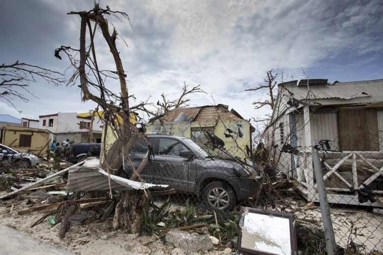 This handout photograph provided courtesy of the Dutch Department of Defense on September 7, 2017 shows houses and cars damaged after the passage of Hurricane Irma on the Dutch Caribbean island of Sint Maarten. (AFP PHOTO/DUTCH DEFENSE MINISTRY/GERBEN VAN ES)
