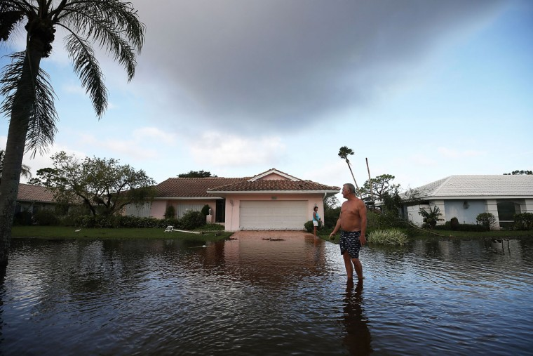 Jerry Darnell stands in front of his house that was flooded by Hurricane Irma on September 9, 2017 in Bonita Springs, Florida. Yesterday Hurricane Irma hit Florida's west coast leaving widespread damage and flooding. (Photo by Mark Wilson/Getty Images)