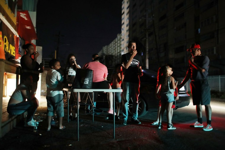 SAN JUAN, PUERTO RICO - SEPTEMBER 23: People hang out as they try to stay cool as they wait for the damaged electrical grid to be fixed after Hurricane Maria passed through the area on September 23, 2017 in San Juan, Puerto Rico. Puerto Rico experienced widespread damage after Hurricane Maria, a category 4 hurricane, passed through. (Photo by Joe Raedle/Getty Images)