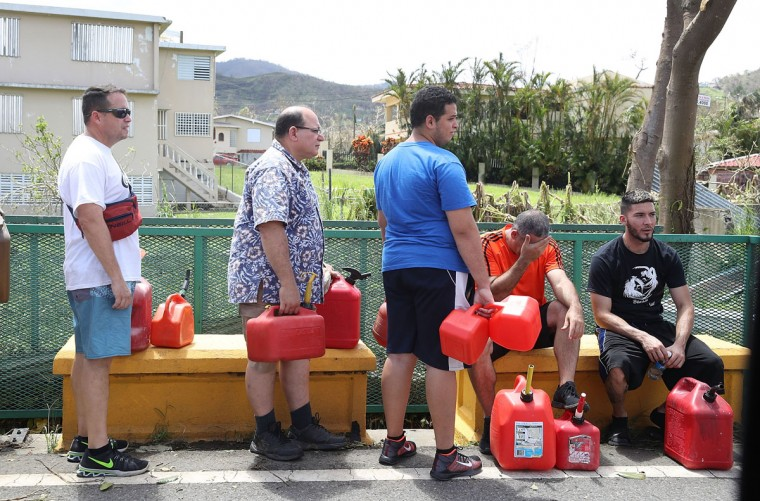 AIBONITO, PUERTO RICO - SEPTEMBER 24: People wait in line for gas as they wait for gas, electrical and water grids to be repaired September 24, 2017 in Aibonito, Puerto Rico. Puerto Rico experienced widespread damage after Hurricane Maria, a category 4 hurricane, passed through. (Photo by Joe Raedle/Getty Images)