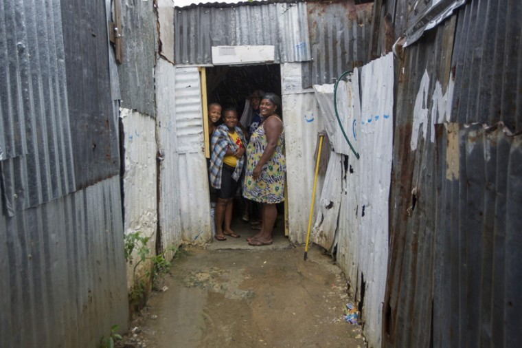 Residents look out of their house in the La Cienaga neighborhood on September 7, 2017, as Hurricane Irma approaches. (ERIKA SANTELICES/AFP/Getty Images)