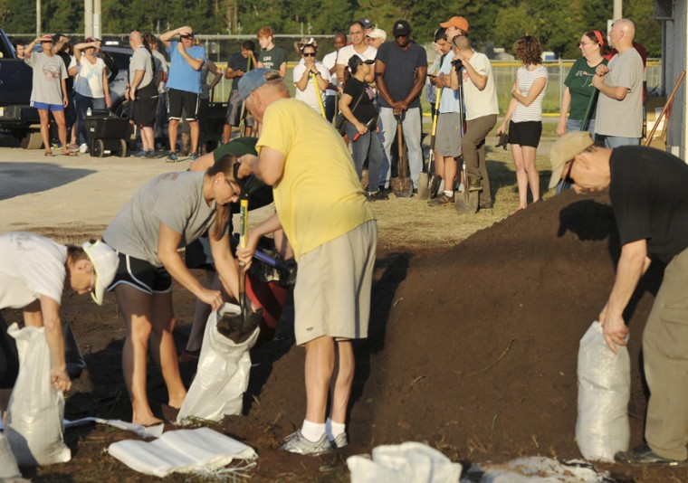 St Johns County Florida residents wait for the arrival of sandbags at Mills Field early September 8, 2017, as those who had their own bags were able to start filling them with sand in Jacksonville, Fla. (Bob Self/The Florida Times-Union via AP)