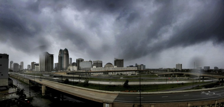 Storms clouds move in over the skyline of downtown Orlando, Fla., as Hurricane Irma makes its way up the Florida peninsula, Sunday, Sept. 10, 2017. (Joe Burbank/Orlando Sentinel via AP)