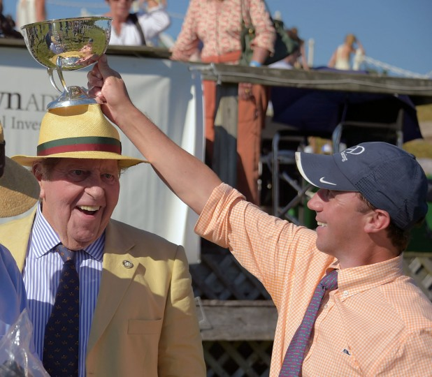 Part owner George Tydings smiles as trainer William Dowling (right) places the trophy above his head after their horse Rodriguez won the Brian Advisory Legacy Chase race, during the 2017 Legacy Chase at Shawan Downs. (Karl Merton Ferron / Baltimore Sun Staff)