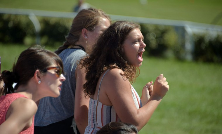 Millie Hege, 13 of Owings Mills cheers for horses competing in the Roundtop Mountain Resort steeplechase, during the 2017 Legacy Chase at Shawan Downs. (Karl Merton Ferron / Baltimore Sun Staff)