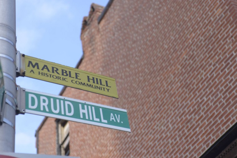 "A sign for ""Marble Hill"" pays homage to the neighborhood's historic past as home to prominent African-American families. (Christina Tkacik/Baltimore Sun)"