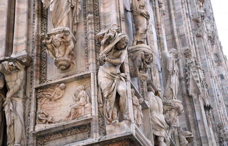 Milan, Italy -- Statues filling the niches in the Duomo of Milan portray biblical and historical figures. The building of this Gothic cathedral commenced in the 13th century and ended in the 19th century with the completion of the facade. (Algerina Perna/Baltimore Sun)