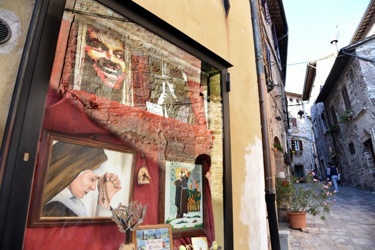 "Assisi, Italy -- An unusual assemblage of images hang in a cabinet on street wall. Inside the shadow box a sign say, ""Il Moderno e Il Cinema.""  (Algerina Perna/Baltimore Sun)"