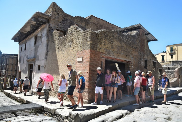 Herculaneum, Italy -- A tour group visits the excavated ruins of the city of Herculaneum which was buried by boiling mud in AD 79 from Mt. Vesuvius's eruption. The first excavation of the city began in 1738 under King Charles of Naples. (Algerina Perna/Baltimore Sun)