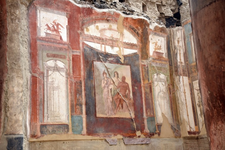 Herculaneum, Italy -- This fresco depicting Hercules in red survived the eruption of Mt. Vesuvius  in AD 79 which covered the city in boiling mud. The fresco is in the College of the Augustali, a religious center worshiping Augustus, which when excavated was partially intact centuries after the eruption. (Algerina Perna/Baltimore Sun)