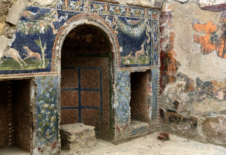 Herculaneum, Italy -- The mosaic-covered nymphaeum which housed statues of nymphs is located in the atrium of an affluent home. The home also houses a mosaic of Neptune and Amphitrite on the adjacent wall. Part of this dwelling survived the catastrophic eruption of Mt. Vesuvius in AD 79 which buried the city with boiling mud that transformed into stone. The first excavations began in 1738 under King Charles of Naples. (Algerina Perna/Baltimore Sun)