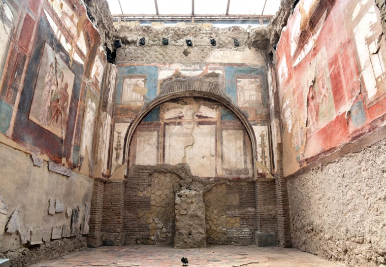 Herculaneum, Italy -- The fresco at left which depicts Hercules in red survived the eruption of Mt. Vesuvius in AD 79 which covered the city in boiling mud. The fresco is in the College of the Augustali, a religious center worshiping Augustus. The first excavation of the city began in 1738 under King Charles of Naples. (Algerina Perna/Baltimore Sun)