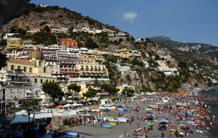 Positano, Italy -- An ancient Roman villa was found on this picturesque site. One can access the top tiers of Positano by roads which wind precariously up the mountainsides, or by traversing several hundred steps leading from sea level to the higher reaches of the city. (Algerina Perna/Baltimore Sun)
