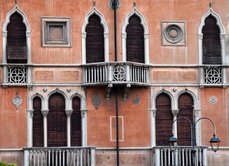 Desenzano del Garda, Italy -- A peach-colored home with Persian-influenced architecture borders an inlet of Lake Garda.(Algerina Perna/Baltimore Sun)