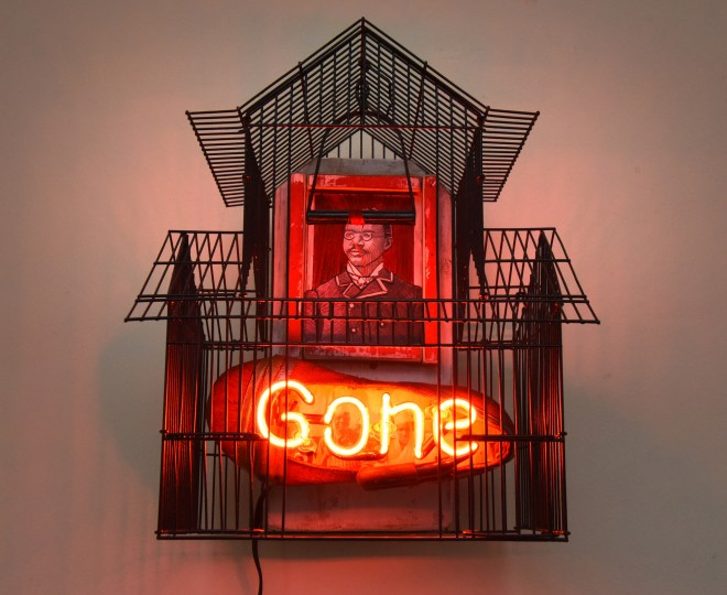 """I Know Why the Caged Bird Sings,"" by William Rhodes, expands the issue of bird extinction to the people of the African diaspora, by introducing a portrait of an African-American man trapped inside a bird cage. The sculpture, in the Peale Center exhibition, ""Birdland and the Anthropocene,"" suggests the confinement and exploitation of all threatened groups. (Amy Davis/Baltimore Sun)"