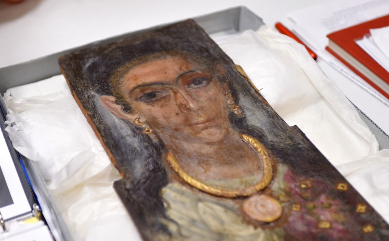 A mummy portrait painted on Beechwood dates to 130-300 AD.    (Lloyd Fox/Baltimore Sun)