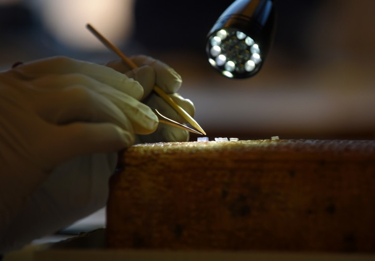 Angie Elliott,  William B. Ziff, Jr. Senior Conservator of Objects at the Walters Art Museum uses small pieces of agrarose gel to help remove damaging salt from this Sumerian Temple Hymn on this clay prism from 1800-1600 BC.  The   (Lloyd Fox/Baltimore Sun)