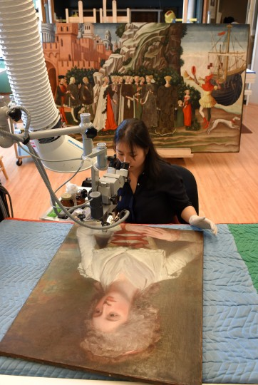 Haemin Park an intern in the painting conservation lab at The Walters Art Museum uses a microscope to analyze the detail on an oil painting by artist, George Romney that dates between 1784-1786.    (Lloyd Fox/Baltimore Sun)