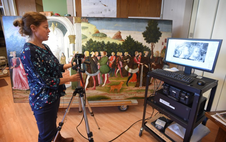 Pamela Betts a senior paintings conservator demonstrates how they use an infrared camera to do reflectography.  They can see the underdrawing of the painting which can show the original drawings the artist made before the painting was started.    (Lloyd Fox/Baltimore Sun)