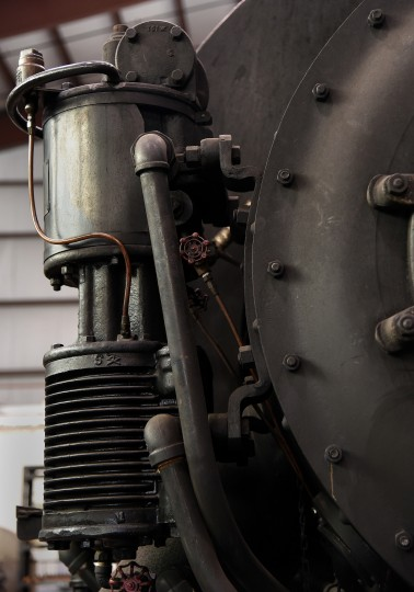 A steam-driven air compressor, used for the brake system, is on the front  of the 1950 St. Elizabeth steam locomotive at the B & O Railroad museum's restoration shop in west Baltimore.    (Barbara Haddock Taylor/Baltimore Sun)