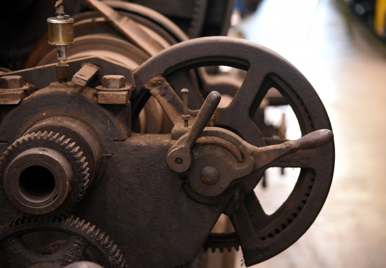 The cast iron gearing of a large lathe, circa 1900, was used to turn the wheel castings for the Pioneer train car replica at the B & O Railroad museum's restoration shop in west Baltimore.    (Barbara Haddock Taylor/Baltimore Sun)
