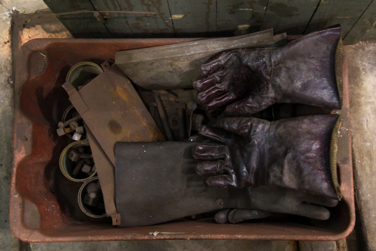 A bin contains work gloves and miscellaneous parts at the B & O Railroad museum's restoration shop in west Baltimore.    (Barbara Haddock Taylor/Baltimore Sun)