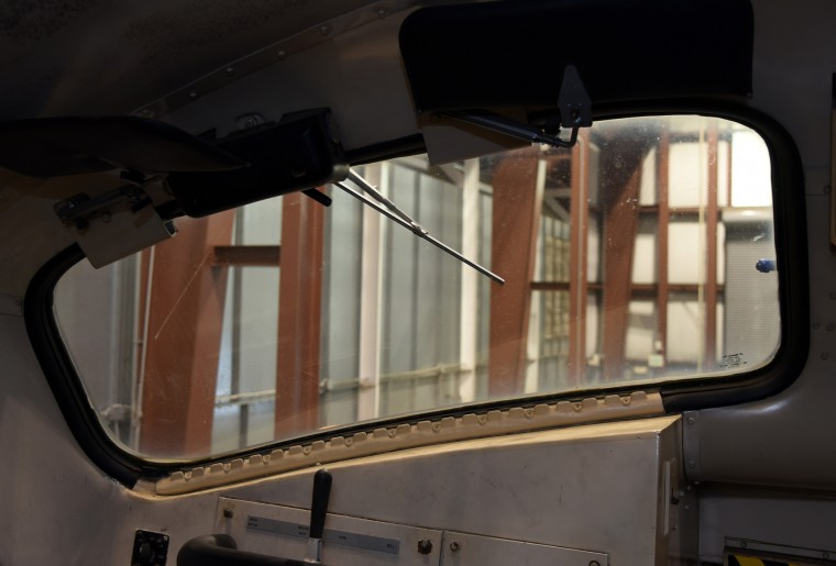 A wiper is viewed through the windshield of a MARC 7100 diesel locomotive in the train's cab.  The locomotive is in the shop for regular maintenance at the B & O Railroad museum's restoration shop in west Baltimore. It pulls passenger cars during the museum's excursion rides. (Barbara Haddock Taylor/Baltimore Sun)