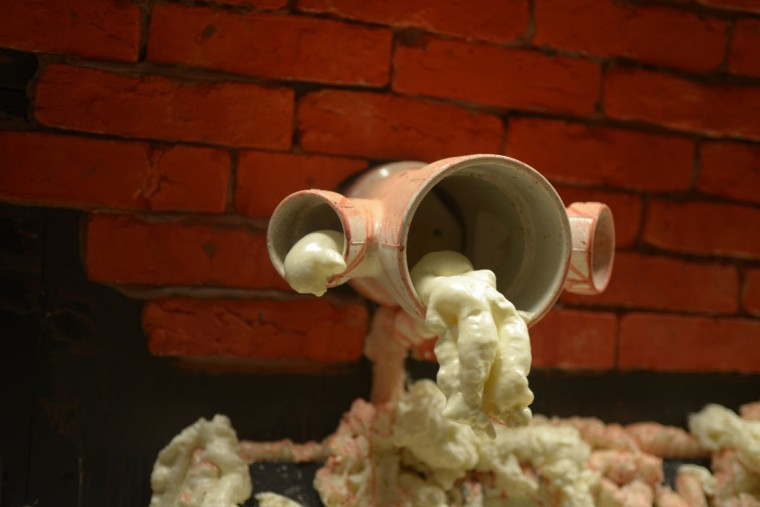 Fake foam oozes out of pipes in a wall of the Nevermore Haunt. The haunted house opens to visitors Oct. 6. (Christina Tkacik/Baltimore Sun)