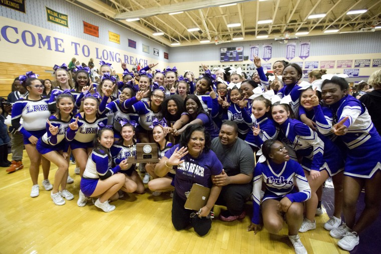 Long Reach cheerleaders pose for a photo after they are announced as the winner of the Howard County Cheerleading Championships at Long Reach High School in Columbia.
