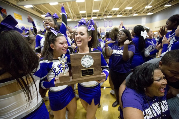 Long Reach cheerleaders react as their team is announced as the winner of the Howard County Cheerleading Championships at Long Reach High School in Columbia.