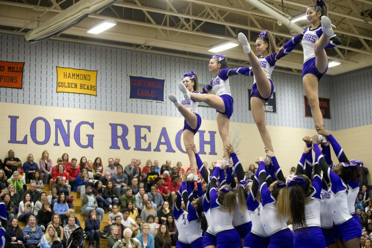 Long Reach competes during the Howard County Cheerleading Championships at Long Reach High School in Columbia.