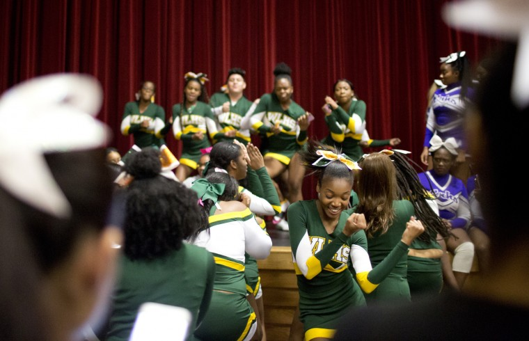 Wilde Lake cheerleaders including Jaidyn Sykes, center, 17, dance before the start of the Howard County Cheerleading Championships at Long Reach High School in Columbia.