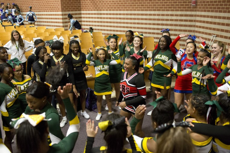 Glenelg's Maya Schenk, 15, dances in the center of the cheerleading dance circle before the start of the Howard County Cheerleading Championships at Long Reach High School in Columbia.