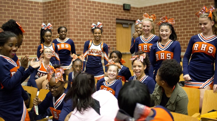 Reservoir cheerleaders gather before the start of the Howard County Cheerleading Championships at Long Reach High School in Columbia.