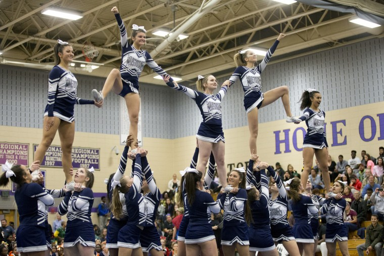 Marriotts Ridge cheerleaders compete during the Howard County Cheerleading Championships at Long Reach High School in Columbia, MD on Thursday, Oct. 26, 2017.
